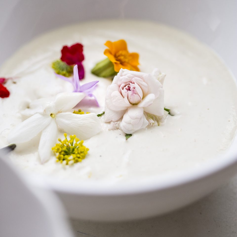 Cashew ajoblanco with edible flowers